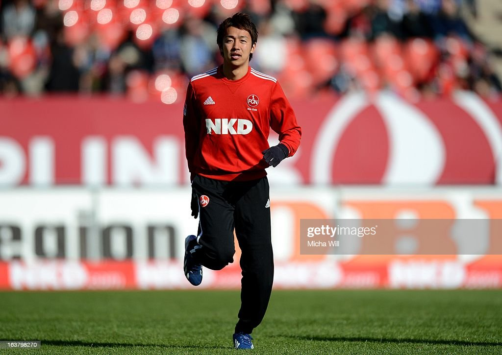 <a gi-track='captionPersonalityLinkClicked' href=/galleries/search?phrase=Hiroshi+Kiyotake&family=editorial&specificpeople=7645519 ng-click='$event.stopPropagation()'>Hiroshi Kiyotake</a> of Nuernberg warms up prior to the Bundesliga match between 1. FC Nuernberg and FC Schalke 04 at Grundig-Stadion on March 16, 2013 in Nuremberg, Germany.