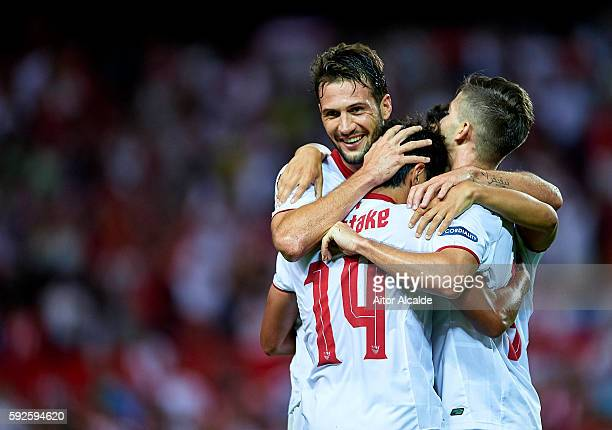 Hiroshi Kiyotake of Sevilla FC celebrates after scoring with his team mates Franco Vazquez and Luciano Vietto during the match between Sevilla FC vs...