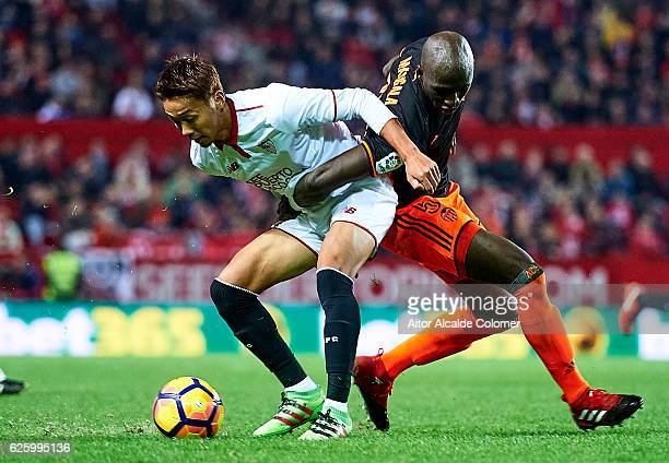 Hiroshi Kiyotake of Sevilla FC competes for the ball with Eliaquim Mangala of Valencia CF during the La Liga match between Sevilla FC and Valencia CF...