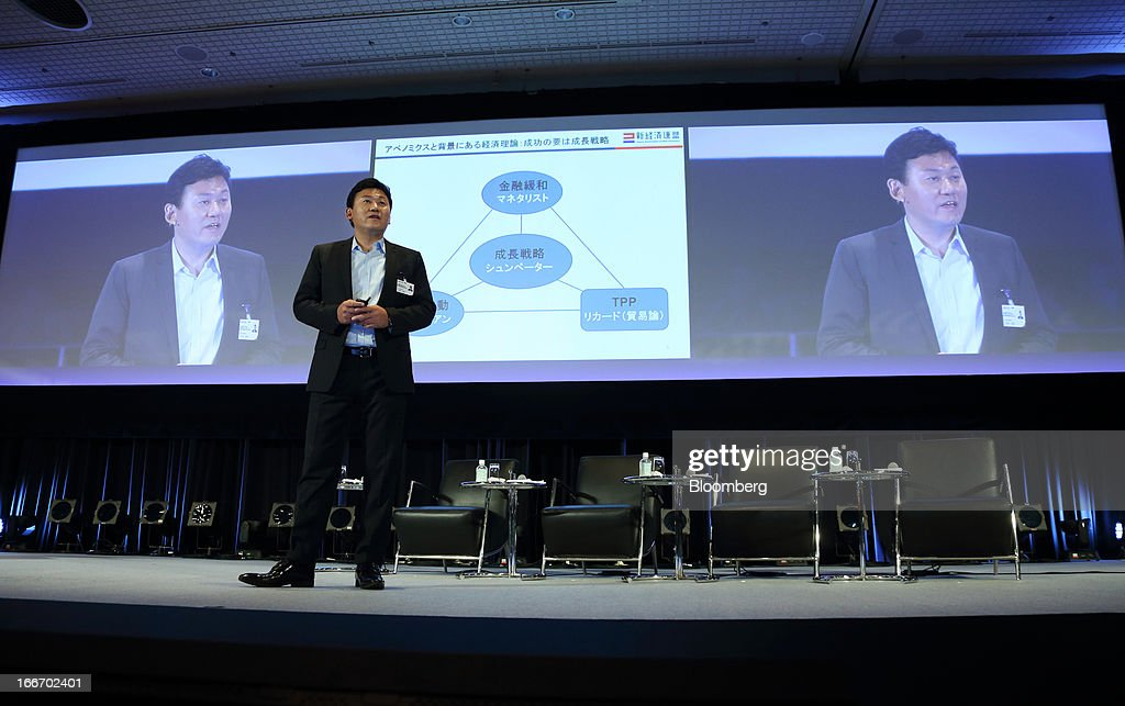 Hiroshi Mikitani, chairman and chief executive officer of Rakuten Inc., speaks at the New Economy Summit 2013 hosted by the Japan Association of New Economy (JANE) in Tokyo, Japan, on Tuesday, April 16, 2013. Mikitani set up the JANE in June after quitting the main business lobby Nippon Keidanren in protest over the group's support for nuclear power. Photographer: Tomohiro Ohsumi/Bloomberg via Getty Images