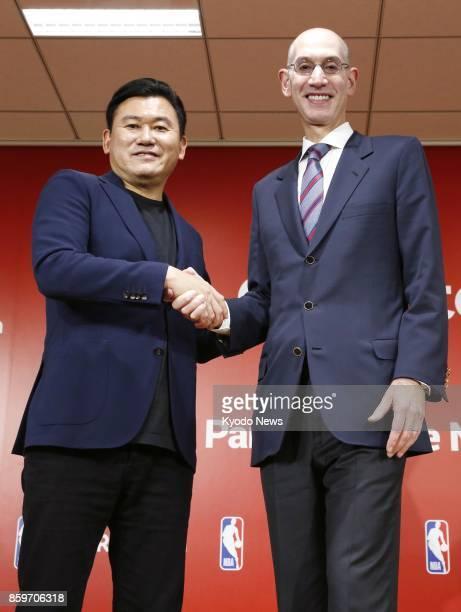 Hiroshi Mikitani chief executive officer of Japanese ecommerce and internet company Rakuten Inc and National Basketball Association Commissioner Adam...