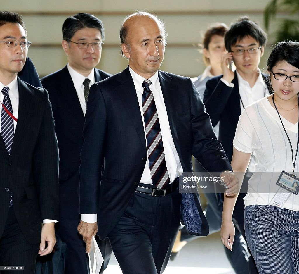 Hiroshi Nakaso (3rd from L), a deputy governor of the Bank of Japan, enters the prime minister's office in Tokyo on June 27, 2016, for a meeting with Prime Minister Shinzo Abe and Finance Minister Taro Aso. The government and the central bank discussed measures to mitigate the impact on the economy from uncertainty over global growth following British voters' decision to leave the European Union.