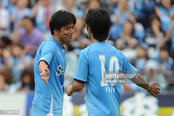 Hiroshi Nanami and Toshiya Fujita in action during the 'ZenzaMatch' before the JLeague match between Jubilo Iwata and FC Tokyo at Yamaha Stadium on...