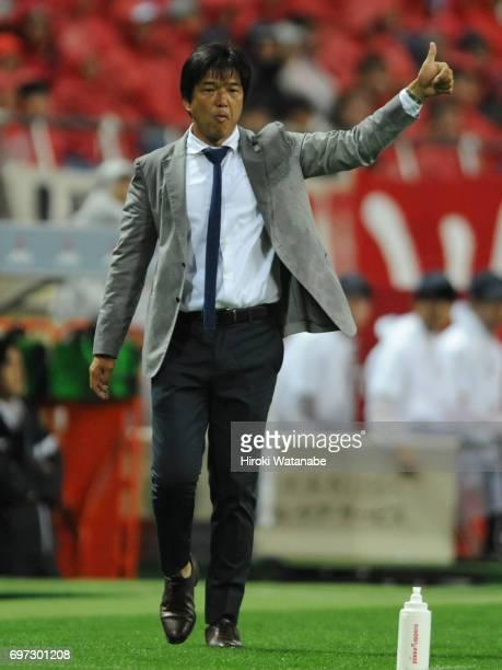Hiroshi Nanami coach of Jubilo Iwata gestures during the JLeague J1 match between Urawa Red Diamonds and Jubilo Iwata at Saitama Stadium on June 18...