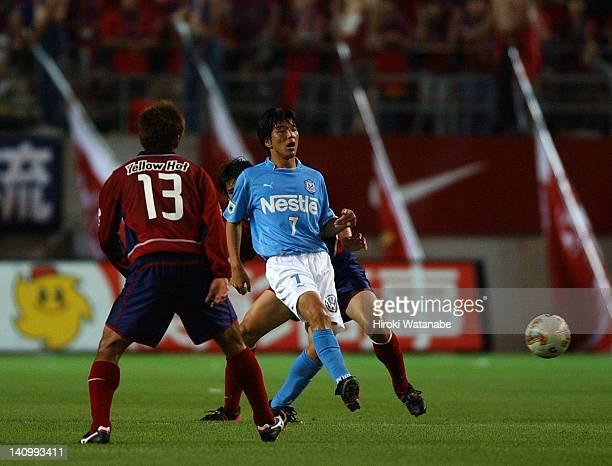 Hiroshi Nanami of Jubilo Iwata and Atsushi Yanagisawa of Kashima Antlers compete for the ball during the JLeague match between Kashima Antlers and...