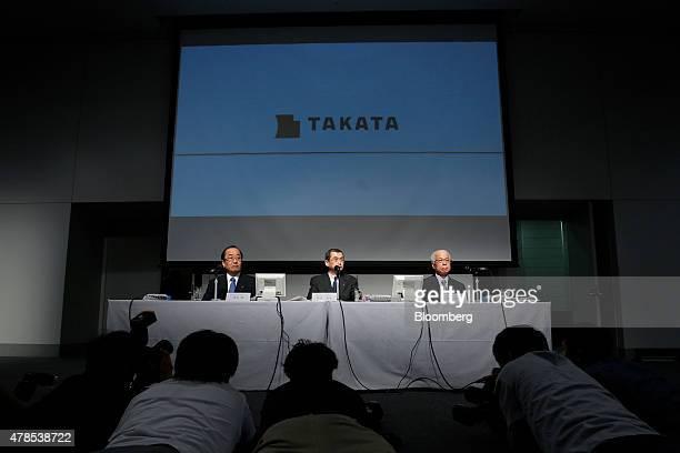 Hiroshi Shimizu executive vice president of Takata Corp from left on stage Shigehisa Takada chairman and president and Yoichiro Nomura chief...