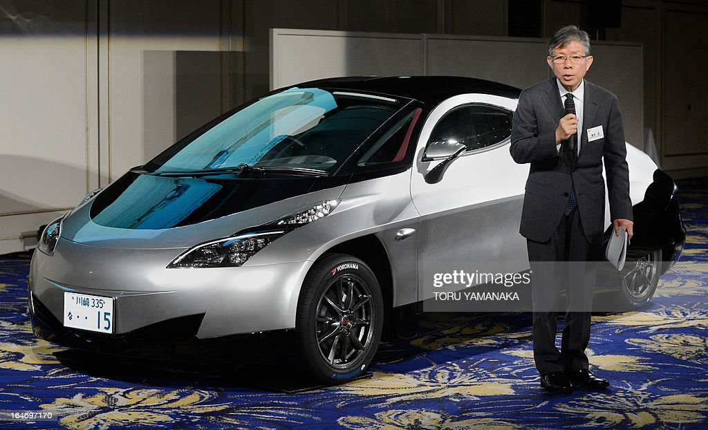Hiroshi Shimizu, president of Japan's auto venture SIM-Drive, introduces its new electric concept car 'SIM-CEL' during a press conference in Tokyo on March 27, 2013. The company is aiming at mass production of the electric vehicle in 2015. AFP PHOTO/Toru YAMANAKA