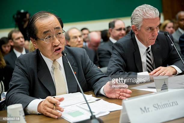 Hiroshi Shimizu senior vice president of global quality assurance at Takata Corp left speaks during a House Energy and Commerce Subcommittee hearing...