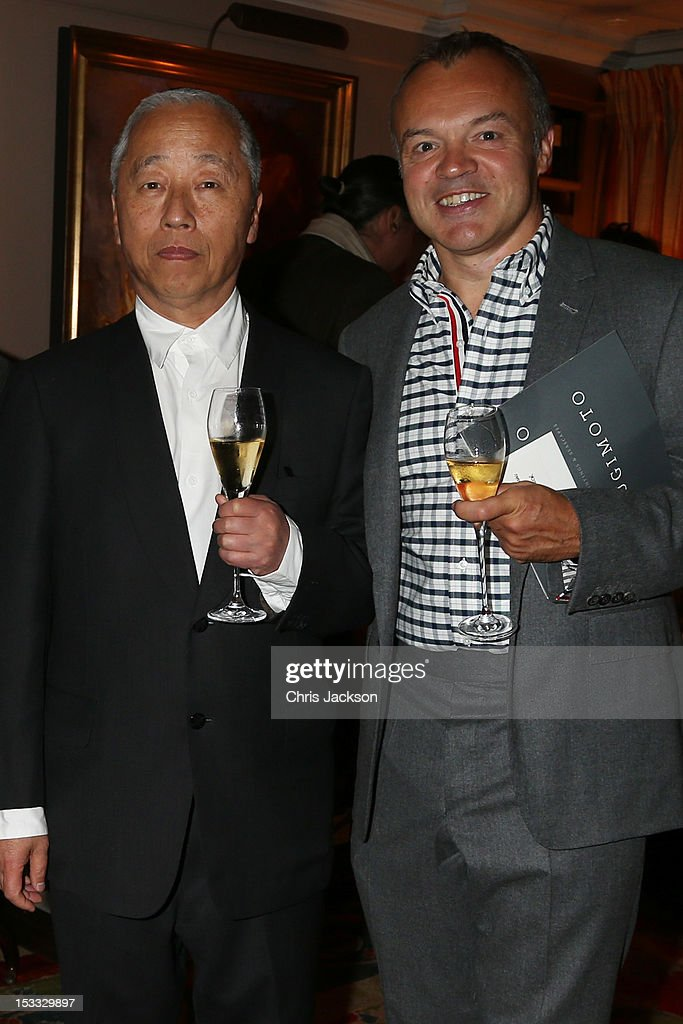 <a gi-track='captionPersonalityLinkClicked' href=/galleries/search?phrase=Hiroshi+Sugimoto&family=editorial&specificpeople=4394679 ng-click='$event.stopPropagation()'>Hiroshi Sugimoto</a> (L) and <a gi-track='captionPersonalityLinkClicked' href=/galleries/search?phrase=Graham+Norton&family=editorial&specificpeople=206423 ng-click='$event.stopPropagation()'>Graham Norton</a> attend a dinner at 5 Hertford Street to celebrate Pace London's opening on October 3, 2012 in London, England. The dinner followed the Private View of the exhibition Rothko/Sugimoto: Dark Paintings and Seascapes at the new Pace London Gallery, 6 Burlington Gardens.