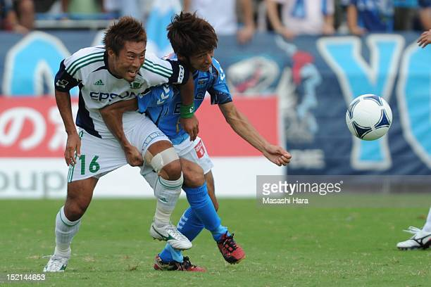 Hiroshi Tetsuto of Matsumoto Yamaga FC and Kensuke Sato of Yokohama FC compete for the ball during the JLeague second division match between Yokohama...