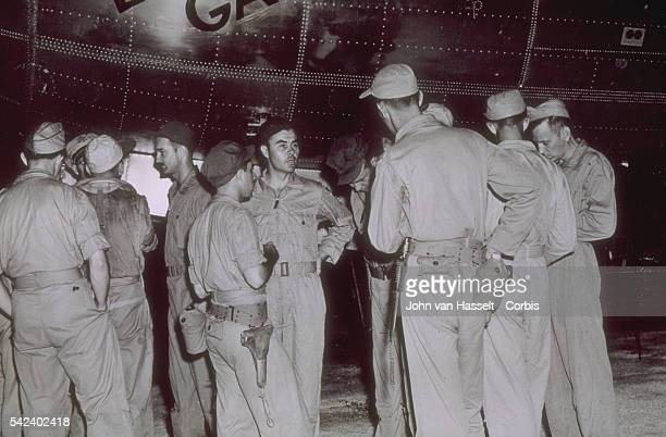 Hiroshima Atomic bomb crew receive last minute instructions from Colonel Tibbets center before taking off Bombardier Thomas Ferebee is in profile...