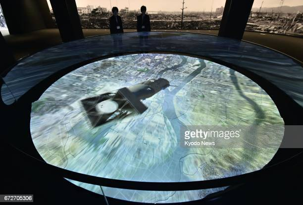 Hiroshima Peace Memorial Museum unveils a computer graphicsbased image of the 1945 atomic bombing of Hiroshima to the media in the western Japanese...