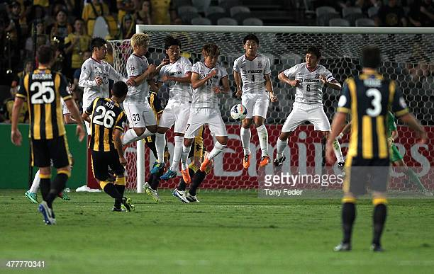 Hiroshima players jump in the air during a Mariners free kick during the AFC Asian Champions League match between the Central Coast Mariners and...