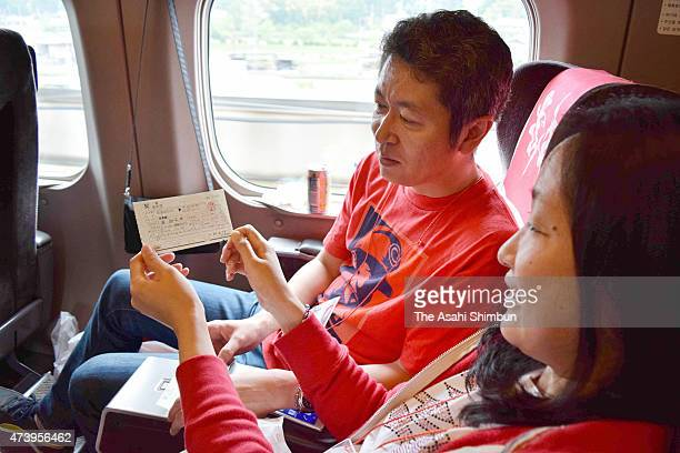 Hiroshima Toyo Carp fans enjoy the atmosphere on the special Shinkansen bullet train for the fans on May 16 2015 in Hiroshima Japan The Japanese...