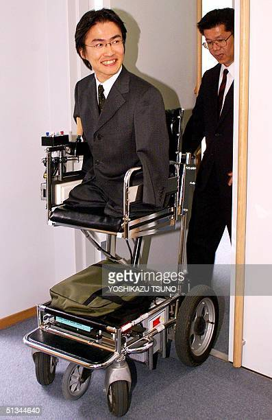 Hirotada Ototake a handicapped senior student of Tokyo's Waseda University enters a room for a press conference with his electric wheel chair as he...