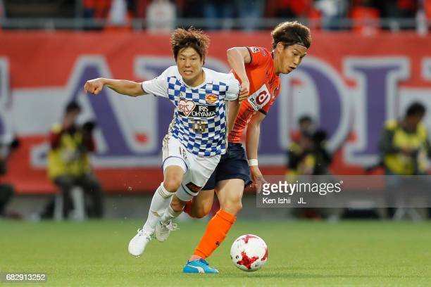 Hirotaka Mita of Vegalta Sendai and Ataru Esaka of Omiya Ardija compete for the ball during the JLeague J1 match between Omiya Ardija and Vegalta...