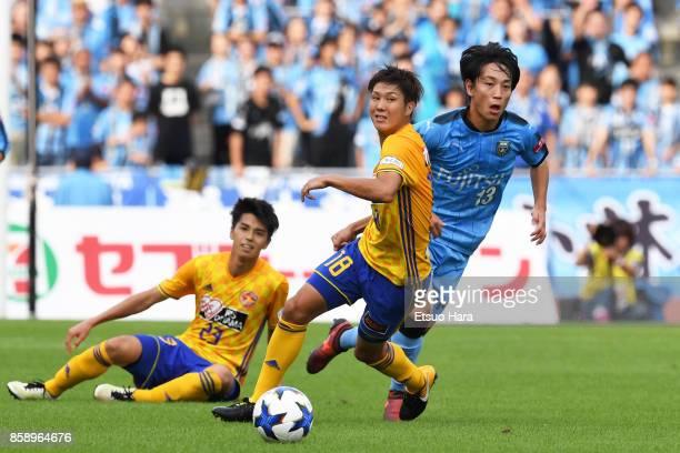 Hirotaka Mita of Vegalta Sendai and Koji Miyoshi of Kawasaki Frontale compete for the ball during the JLeague Levain Cup semi final second leg match...