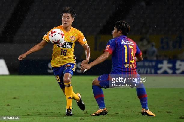 Hirotaka Mita of Vegalta Sendai and Yoshito Okubo of FC Tokyo compete for the ball during the JLeague J1 match between FC Tokyo and Vegalta Sendai at...