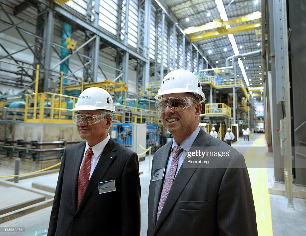 Hiroya Kawasaki, president of Kobe Steel Ltd., left, and John Surma, chairman and chief executive officer of United States Steel Corp., smile during a tour of the Continuous Annealing Line (CAL) at the PRO-TEC Coating Co. facility in Leipsic, Ohio, U.S., on Monday, May 13, 2013. PRO-TEC Coating Co. was established as a joint venture in 1990 by two global leaders in steel technology and production: United States Steel Corp. and Kobe Steel Ltd. of Japan. Photographer: Jeff Kowalsky/Bloomberg via Getty Images