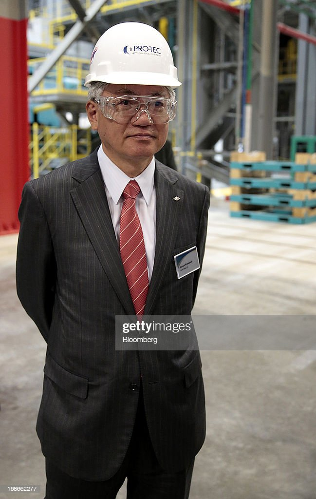 Hiroya Kawasaki, president of Kobe Steel Ltd., tours the Continuous Annealing Line (CAL) at the PRO-TEC Coating Co. facility in Leipsic, Ohio, U.S., on Monday, May 13, 2013. PRO-TEC Coating Co. was established as a joint venture in 1990 by two global leaders in steel technology and production: United States Steel Corp. and Kobe Steel Ltd. of Japan. Photographer: Jeff Kowalsky/Bloomberg via Getty Images