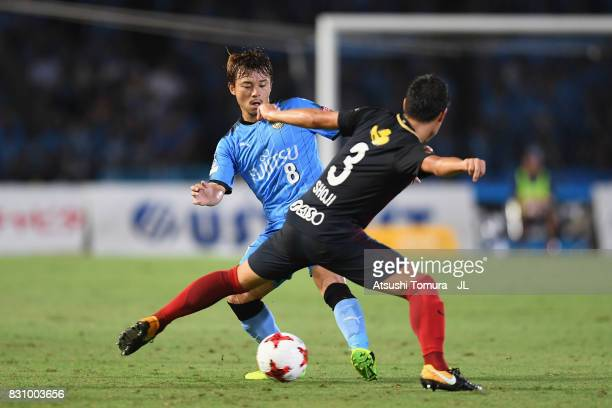 Hiroyuki Abe of Kawasaki Frontale and Gen Shoji of Kashima Antlers compete the ball during the JLeague J1 match between Kawasaki Frontale and Kashima...