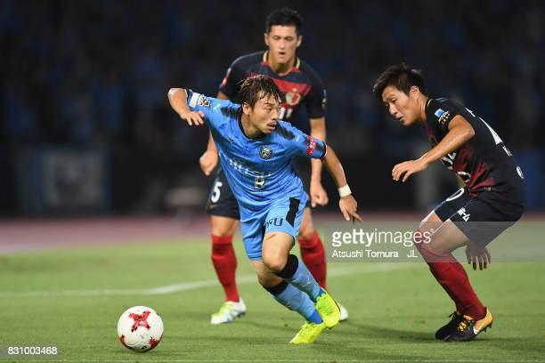 Hiroyuki Abe of Kawasaki Frontale and Kento Misao of Kashima Antlers compete for the ball during during the JLeague J1 match between Kawasaki...