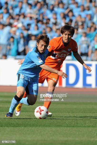Hiroyuki Abe of Kawasaki Frontale and Teruki Hara of Albirex Niigata compete for the ball during the JLeague J1 match between Kawasaki Frontale and...