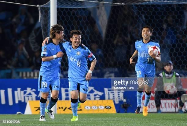 Hiroyuki Abe of Kawasaki Frontale celebrates scoring his side's first goal with his team mates Kentaro Moriya and Yu Kobayashi during the JLeague J1...