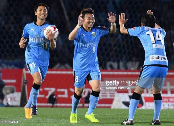 Hiroyuki Abe of Kawasaki Frontale celebrates scoring his side's first goal with his team mates Kengo Nakamura and Yu Kobayashi during the JLeague J1...
