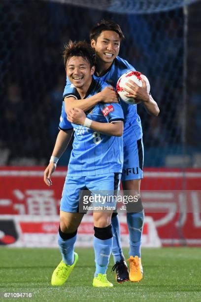 Hiroyuki Abe of Kawasaki Frontale celebrates scoring his side's first goal with his team mate Yu Kobayashi during the JLeague J1 match between...