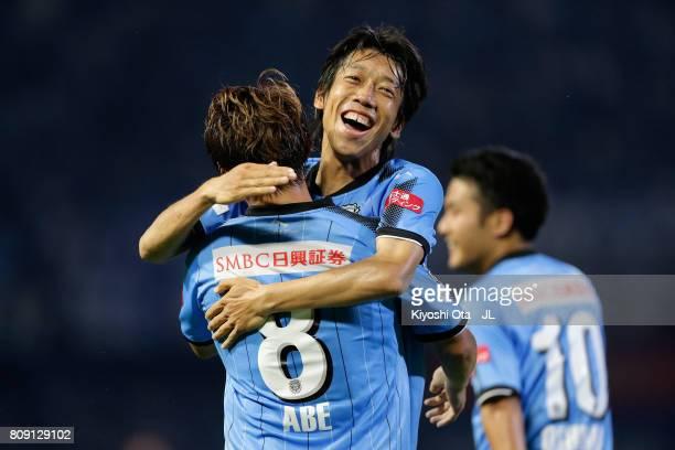 Hiroyuki Abe of Kawasaki Frontale celebrates scoring his side's second goal with his team mate Kengo Nakamura during the JLeague J1 match between...