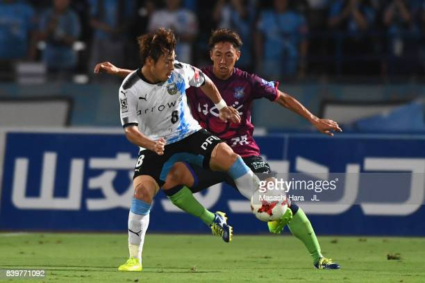 Hiroyuki Abe of Kawasaki Frontale controls the ball under pressure of Yuki Hashizume of Ventforet Kofu during the JLeague J1 match between Ventforet...