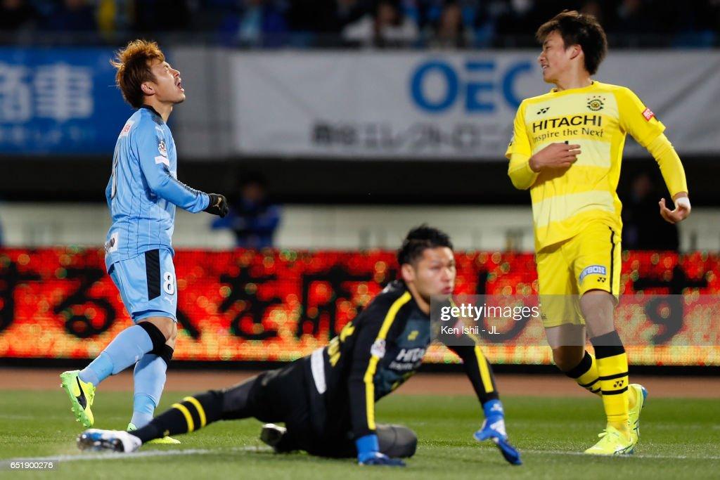 Hiroyuki Abe (L) of Kawasaki Frontale reacts after missing a chance during the J.League J1 match between Kawasaki Frontale and Kashiwa Reysol at Todoroki Stadium on March 10, 2017 in Kawasaki, Kanagawa, Japan.
