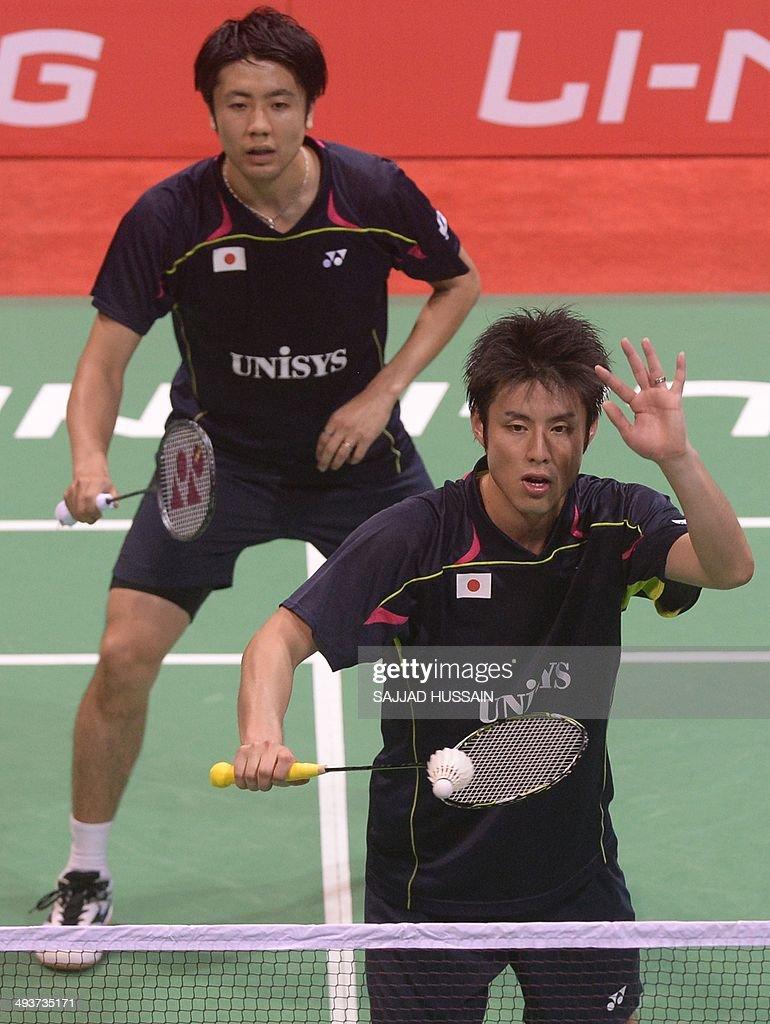 Hiroyuki Endo L and Kenichi Hayakawa of Japan play a return to