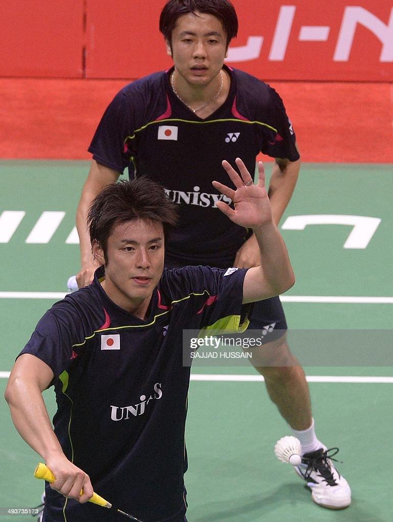 Hiroyuki Endo R and Kenichi Hayakawa of Japan play a return to