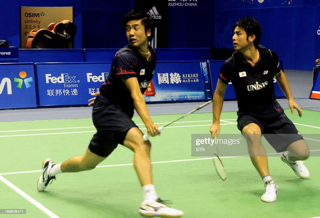 Hiroyuki Endo (L) and Kenichi Hayakawa of Japan return a shot against Ko Sung Hyun and Lee Yong Dae of South Korea during the men's doubles final match of the 2013 China Masters in Changzhou, east China's Jiangsu province on September 15, 2013. Ko and Lee won 25-23, 21-19. CHINA