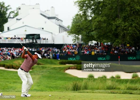 Hiroyuki Fujita of Japan hits his tee shot on the 13th hole during Round One of the 113th US Open at Merion Golf Club on June 13 2013 in Ardmore...