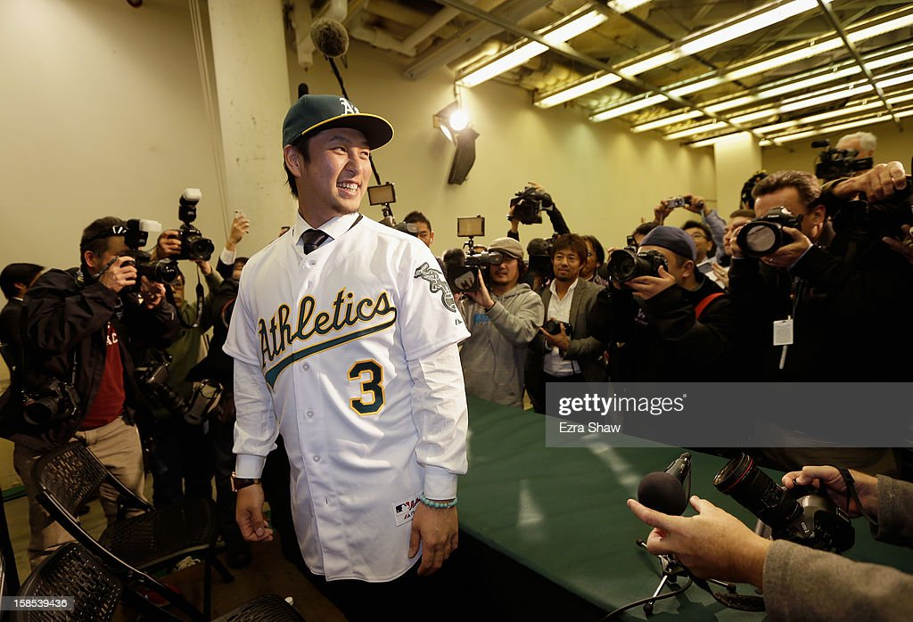 Hiroyuki Nakajima of Japan poses for photographers after he was introduced by the Oakland Athletics at the O.co Coliseum on December 18, 2012 in Oakland, California. Nakajima signed a two-year contract through 2014 with a club option for 2015.