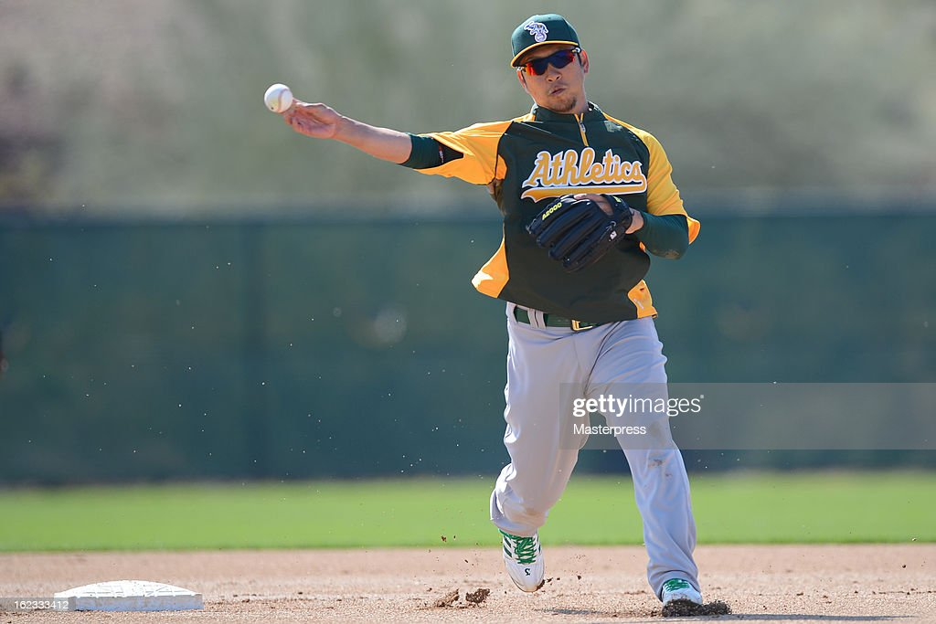 Hiroyuki Nakajima of Oakland Athletics fields during Oakland Athletics Spring Training at Papago Park on February 21, 2013 in Phoenix, Arizona.