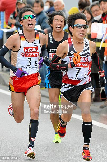 Hiroyuki Ono of Nissin Foods Group Tsuyoshi Ugachi of Konica Minolta and Minato Oishi of Toyota Motor Co compete during the 59th New Year Ekiden on...