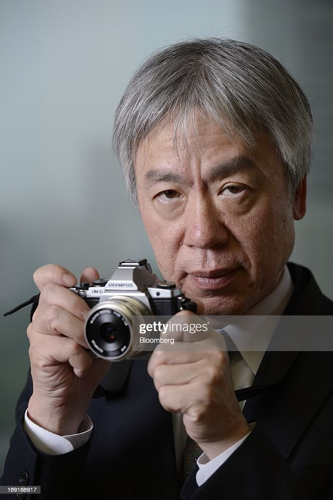 <a gi-track='captionPersonalityLinkClicked' href=/galleries/search?phrase=Hiroyuki+Sasa&family=editorial&specificpeople=8947910 ng-click='$event.stopPropagation()'>Hiroyuki Sasa</a>, president and chief executive officer of Olympus Corp., speaks during an interview in Tokyo, Japan, on Monday, May 20, 2013. Olympus Corp. said sales of its compact cameras may fall by half next fiscal year, extending a decline as consumers increasingly use smartphones such as Apple Inc.'s iPhone to take pictures. Photographer: Akio Kon/Bloomberg via Getty Images