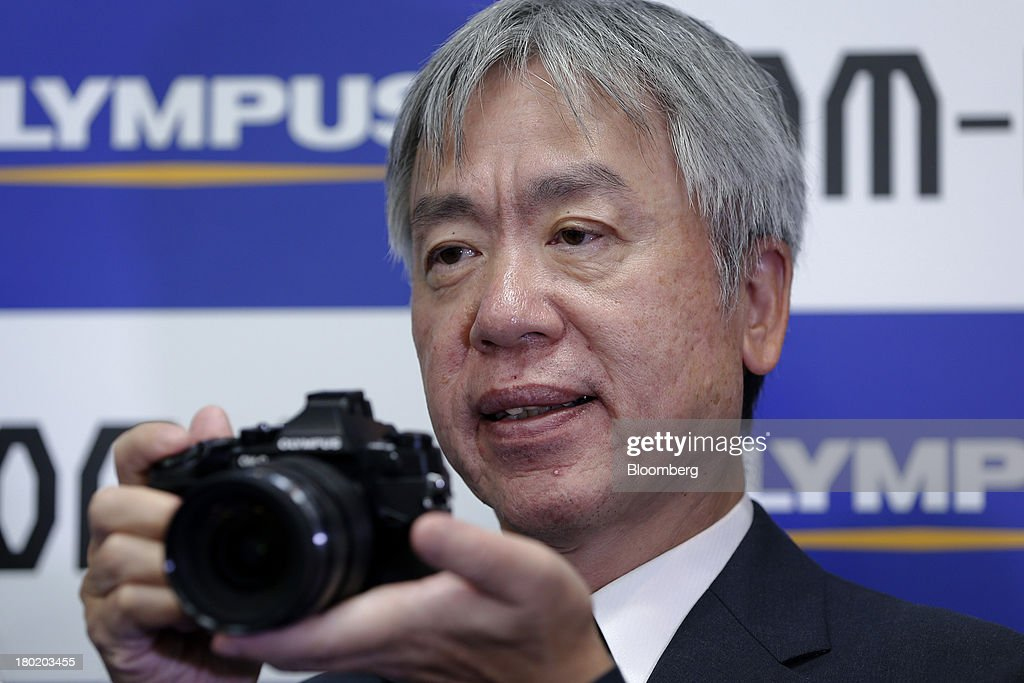 <a gi-track='captionPersonalityLinkClicked' href=/galleries/search?phrase=Hiroyuki+Sasa&family=editorial&specificpeople=8947910 ng-click='$event.stopPropagation()'>Hiroyuki Sasa</a>, president of Olympus Corp., holds the company's OM-D E-M1 micro four-thirds camera at its unveiling in Tokyo, Japan, on Tuesday, Sept. 10, 2013. Olympus, which produced its first camera in 1936, is the world's biggest maker of endoscopes. Photographer: Kiyoshi Ota/Bloomberg via Getty Images