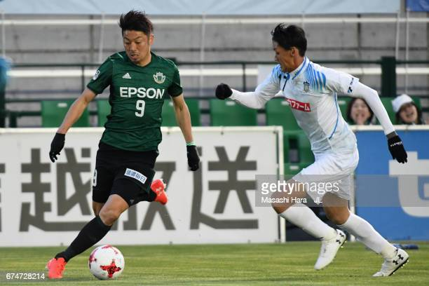 Hiroyuki Takasaki of Matsumoto Yamaga takes on Lee Yon Jick of Kamatamare Sanuki during the JLeague J2 match between Matsumoto Yamaga and Kamatamare...