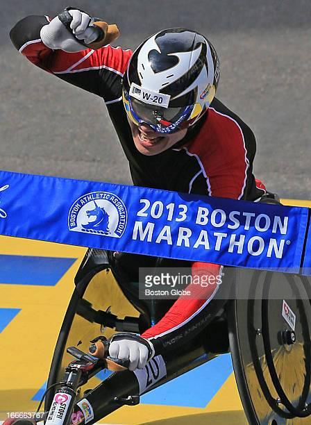 Hiroyuki Yamamoto of Japan crosses the finish line to win the men's wheelchair race at the 117th Boston Marathon on April 15 2013