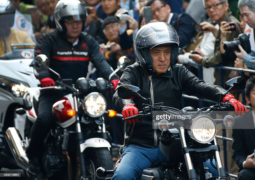 Hiroyuki Yanagi, president and chief executive officer of Yamaha Motor Co., front, rides the company's Bolt-R motorcycle during the 60th Anniversary Tokyo Motor Show Parade held ahead of the 44th Tokyo Motor Show 2015 in Tokyo, Japan, on Saturday, Oct. 24, 2015. The Tokyo Motor Show will run from Oct. 29 through Nov. 8. Photographer: Tomohiro Ohsumi/Bloomberg via Getty Images