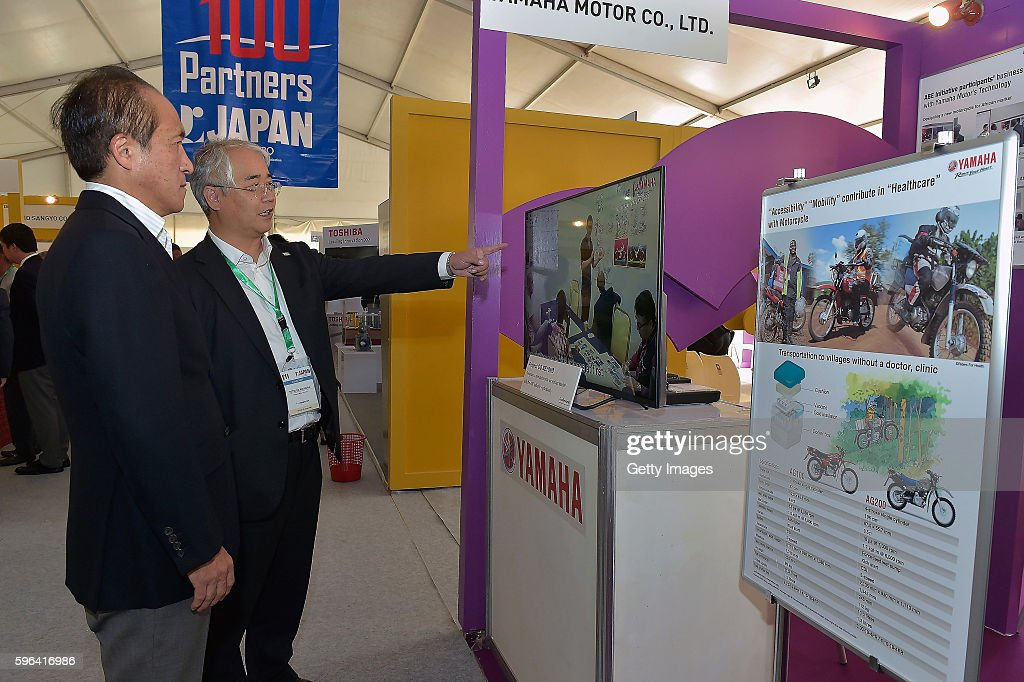 Hiroyuki Yanagi President CEO and Representative Director of Yamaha Motor Co Ltd visits the Yamaha booth during the Tokyo International Conference on...