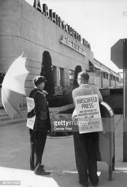Hirschfeld Picketed Two unidentified pickets parade in front of A B Hirschfeld Press Speer Blvd and Acoma St Tuesday in what company official called...