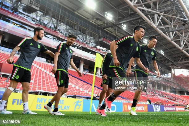 Hirving Lozano and Hector Herrera warm up during the Mexico training session on July 1 2017 in Moscow Russia