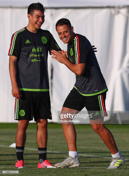 Hirving Lozano and Javier Hernandez smile during a Mexico training session at Adler training ground ahead of their FIFA Confederations Cup Russia...