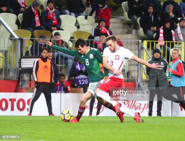 Hirving Lozano and Maciej Rybus during the international friendly soccer match between Poland and Mexico at the Energa Stadium in Gdansk Poland on 13...